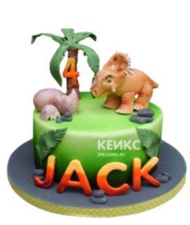 Торт с фигуркой маленького динозавра на лужайке