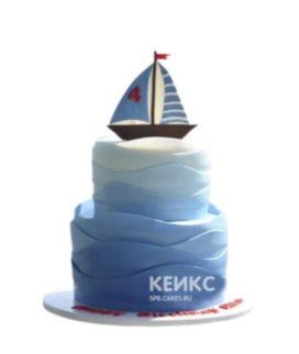 Синий торт обмре с корабликом и волнами