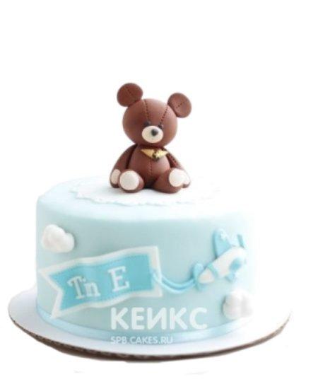 Торт голубого цвета с фигуркой медведя