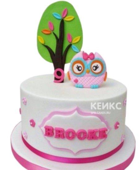 Детский розовый торт с милым совенком из мастики
