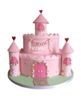 Торт в виде розового замка с башнями