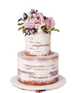 Голый двухъярусный свадебный торт с букетом ярких цветов