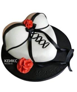 Торт на мальчишник в виде груди в белом корсете с черной лентой