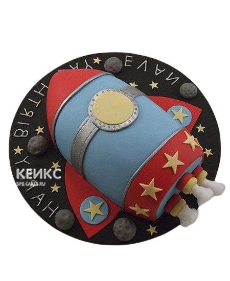 Торт в виде красно-синей ракеты
