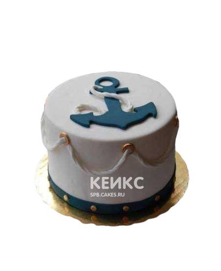 Белый торт для моряка с якорем и канатами