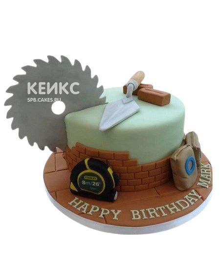 Зеленый торт с рулеткой и шпателем для строителя