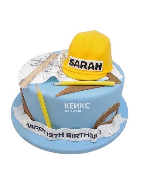 Синий торт с каской и чертежом для строителя