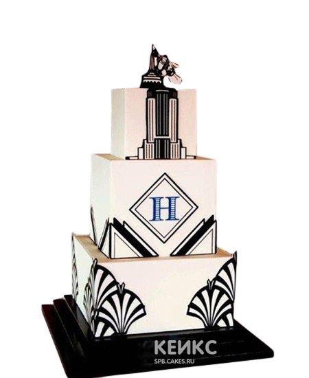 Элегантный черно-белый торт в виде небоскреба с логотипом