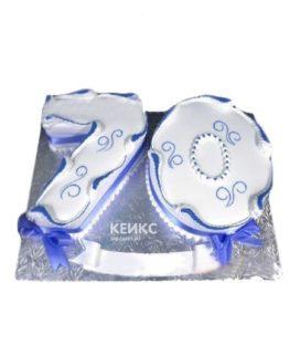 Бело-синий торт в форме цифры с бантиками