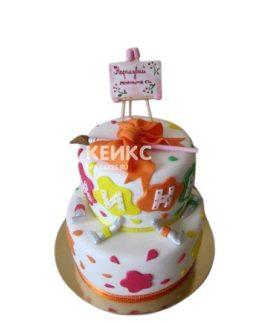 Торт с разноцветными кляксами и бантом