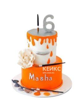 Оранжево-белый торт с кисточками