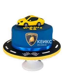 Синий торт с желтой машинкой и дорогой