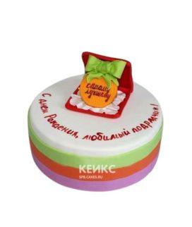 Белый торт с медалью и зеленым бантом