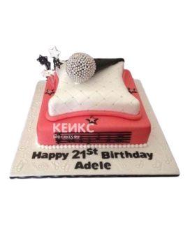 Бело-розовый торт микрофон на подушке