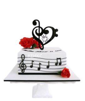 Торт украшенный скрипичным ключом, нотами и цветами