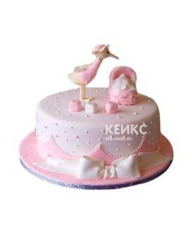 Розовый торт с аистом на рождение девочки
