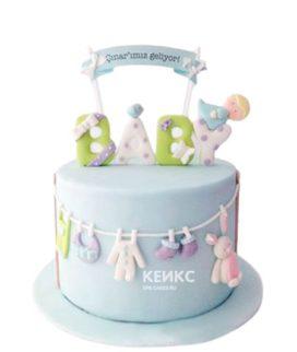 Торт голубого цвета с надписью на рождение мальчика