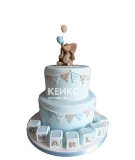 Голубой двухъярусный торт на выписку со слоненком и шариками