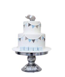 Двухъярусный торт на выписку со слоненком, кубиками и флажками