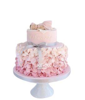 Розовый торт на выписку с фигуркой девочки