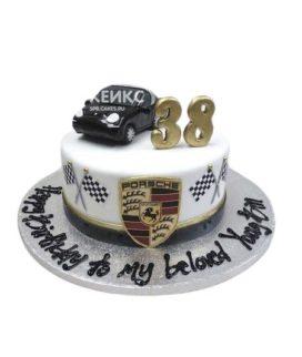 Торт для мужчины с эмблемой и машинкой Порше из мастики