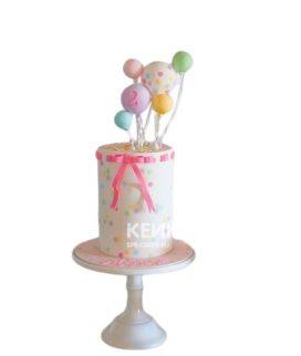 Разноцветный торт с шариками и розовым бантиком