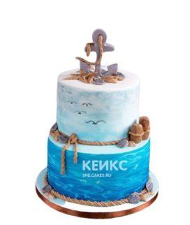 Синий двухъярусный торт с якорем в морском стиле