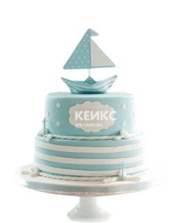 Голубой полосатый торт с корабликом и канатами в морском стиле