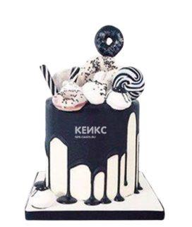 Черно-белый торт со сладостями