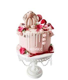Розовый торт с зайцем и сладостями для девушки на 15 лет