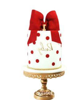 Красно-белый торт в горошек с большим бантом