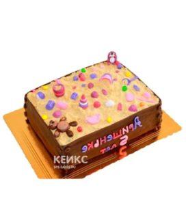 Детский торт в виде большой песочницы с розовыми игрушками