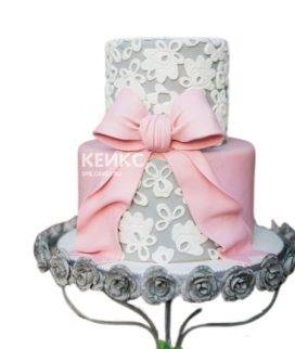 Недорогой свадебный торт с розовым бантом