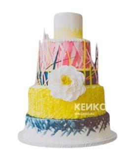 Свадебный торт в стиле бохо с разноцветными ярусами и цветком