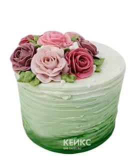 Торт в зеленых тонах с разноцветными розами