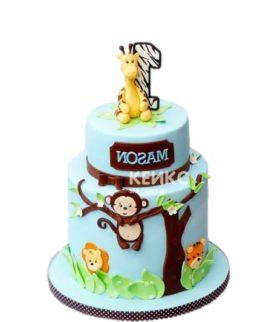 Забавный детский торт украшенный обезьянкой из мастики