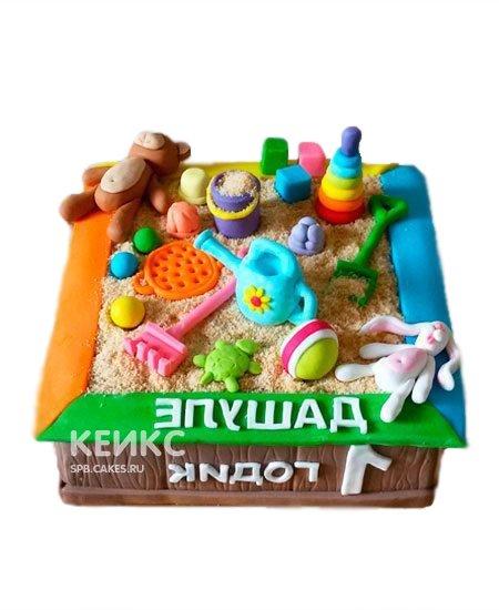 Торт в виде песочницы с игрушками
